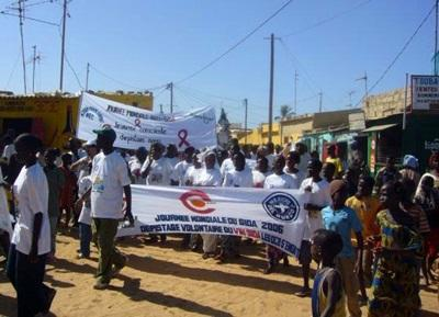 Interns on the Human Rights Project in Senegal Walk in an AIDS March