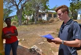A Human Rights interns take part in an activity at a local school in Jamaica during his volunteer project.