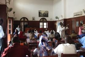 Volunteers and staff on the Human Rights Internship in Senegal attend a community meeting.