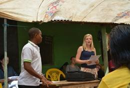 A volunteer and staff member on the Human Rights Project in Ghana have a meeting.