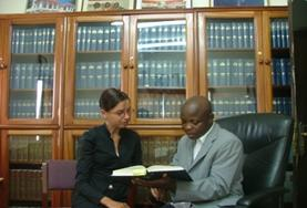 A volutneer learns from her supervisor on the International Law Internship in Ghana.