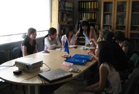 Volunteers on the Law Project in Mongolia attend a meeting with staff.