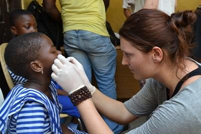 Volunteer does teeth cleanings for children in Ethiopia with Projects Abroad