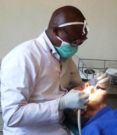A Dentistry intern performs a routine check-up in Kenya