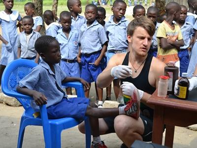 Medical intern working with a child on a Medicine project in Ghana