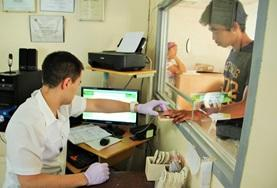 A medical intern in the Philippines assists with desk duty as part of his project work.