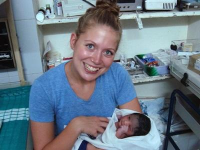 A Midwifery student with an infant that had just been born at a hospital in India