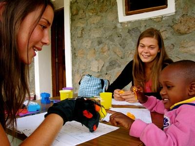 A small child takes part in educational activities with Projects Abroad volunteers
