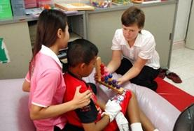 An Occupational Therapy intern works with a child in Phnom Penh, Cambodia.