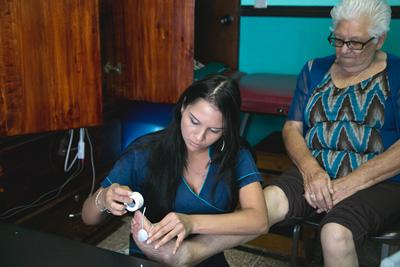 An intern working at the day center for the elderly in Costa Rica