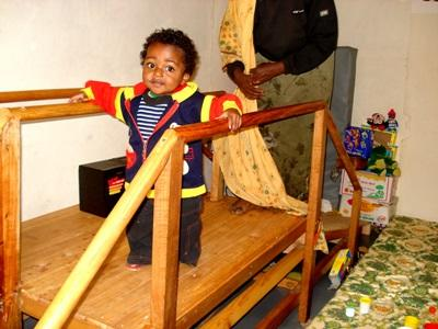 Child practices assisted walking with volunteers on the Physical Therapy Project in Ethiopia