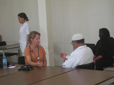 A Moroccan man gets his vitals checked by a Projects Abroad intern