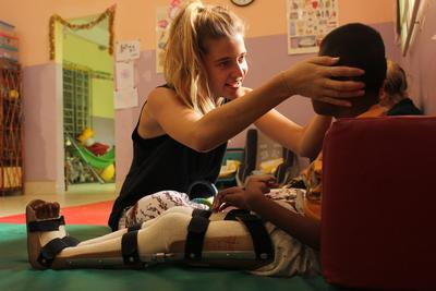 A volunteer working at a disabilities center