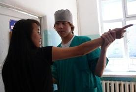 A Physical Therapy volunteer in Mongolia learns a new technique from local staff.