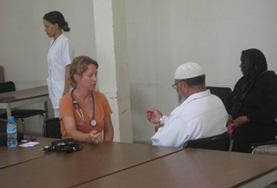 A physical therapy intern in Morocco speaks to a man at her placement.