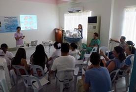 A physical therapy intern in the Philippines gives a presentation.
