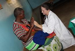 In Tanzania, a Physical Therapy Intern in dar es Salaam helps a patient during a session.