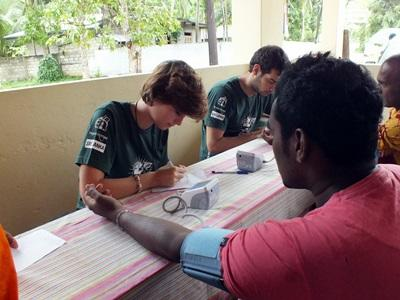 : A Sri Lankan man has his blood pressure measured by a Projects Abroad Public Health intern.