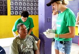 A young girl waits to be assisted on the Belize Public Health Project.