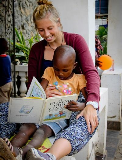 A child in Tanzania receives teaching lessons from a Projects Abroad volunteer