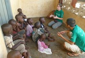 Volunteers on their Speech Therapy Project abroad speak to young children.