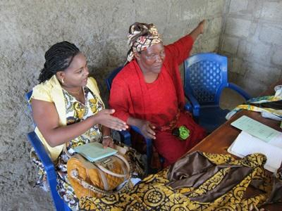 Interns on the Microfinance project works with local seamstress to give small loans for international development