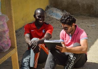 Projects Abroad Microfinance intern works with a project beneficiary in St Louis, Senegal.