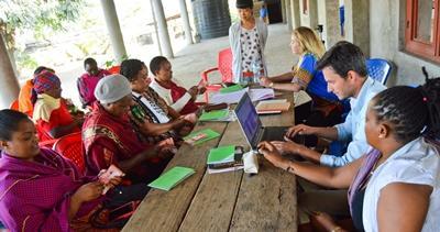 Volunteer on the Microfinance project interviews local woman to understand international development in Tanzania