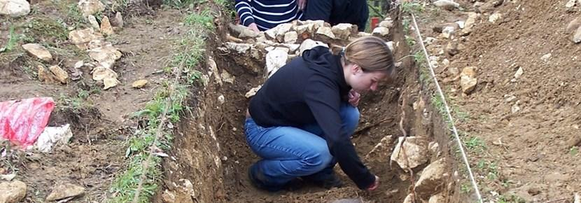 Skilled volunteers studying soil on a professional archaeology volunteer project