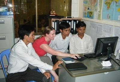 A professional Consulting volunteer working with locals in Cambodia