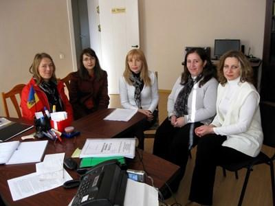 Consulting volunteers in a project meeting in Romania