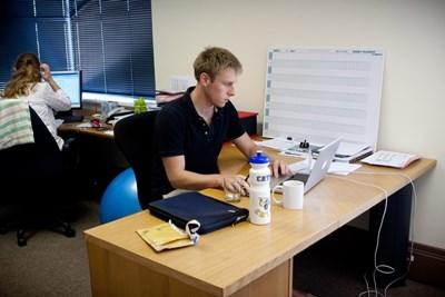 A professional volunteer business consultant in his office in Cambodia.