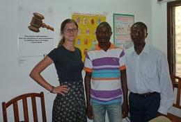 A professional psychologist speaks to locals in Togo clinic.