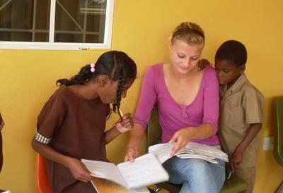 Professional Social Work Volunteer guiding children in Jamaica