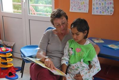 Skilled Social Worker volunteering with children in Romania
