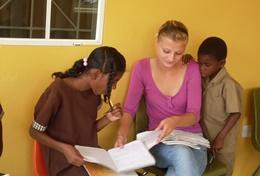 Jamaican children receive assistance from a professional social worker volunteering in Jamaica.