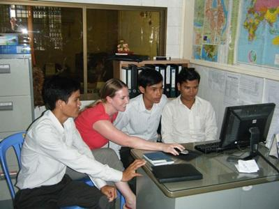 Journalism intern works with staff on a project in the office in Cambodia