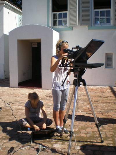 Intern on the Journalism project in Jamaica records a broadcast in a local community