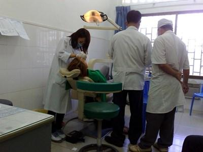 Skilled dentist works in a dental clinic treating patients in Cambodia