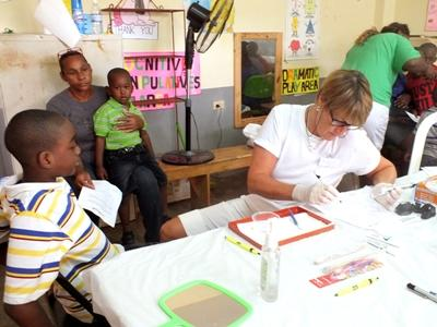 Skilled dentist does outreach work to improve children's dental work