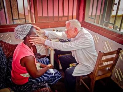Qualified doctor examining patient on a professional project in Ghana