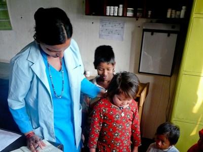 Professional nursing volunteer working with child in Nepal