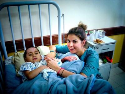 Professional occupational therapy volunteer with child at placement in Bolivia