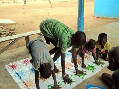 Volunteers on the Occupational Therapy project in Ghana give children coordination games