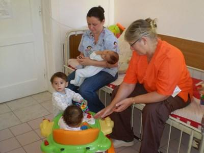 Professional occupational therapy volunteers working with children in Romania
