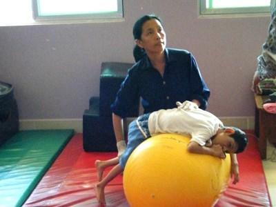 Professional volunteer with patient on professional physical therapy project in Cambodia