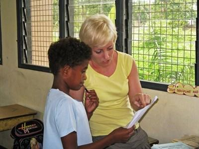 Professional speech therapist working with patient on project in Fiji