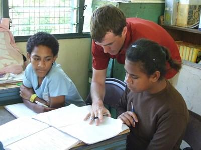 Professional volunteer guiding speech therapy patients in Fiji