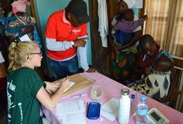 A professional volunteer midwife works with two newborn babies on the Midwifery Project in Tanzania.