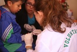 Volunteer nurses work to help patients in a hospital, based in Peru.